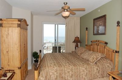 Beachside master br with king bed and bamboo/rattan headboard and flatscreen TV