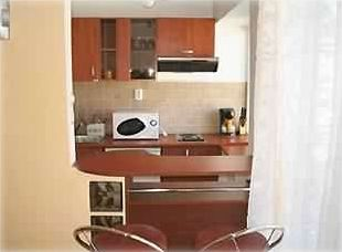 Fully equiped kitchen with microwave, coffee maker, silverware, plates, glasses.