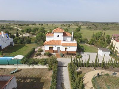 Photo for Spacious villa with great views of the golf course on the Guadiana and Portugal