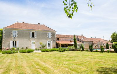 Photo for Stunning, 6 Bed House, Heated Pool, Gated garden 1.5 Acres, great for families!