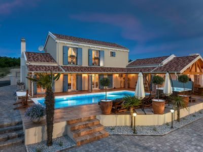 Photo for 5* Luxury villa 300m from the beach with large pool, jacuzzi and tennis court
