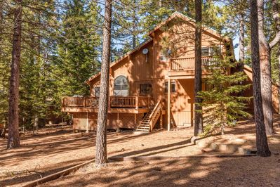 Exterior - Lots of tall trees surround this rustic home.