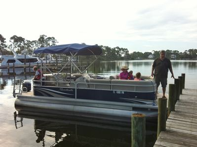 Board a boat from the dock. Public boat launch 1/2 mile away. Bring your boat.