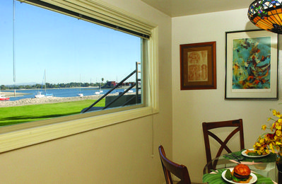 Dining area looking out front window to the sand and water