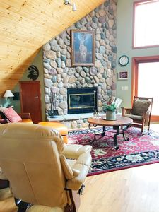 Cozy wood-burning fireplace with sitting area (firewood provided)