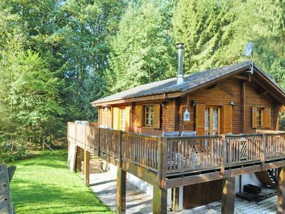 Photo for Charming, wooden chalet with sauna in a forested location near Durbuy