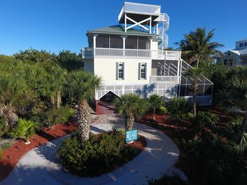 Manatee Haven: Upscale Beach View Home with Screened-in Pool, Spa & Elevator.