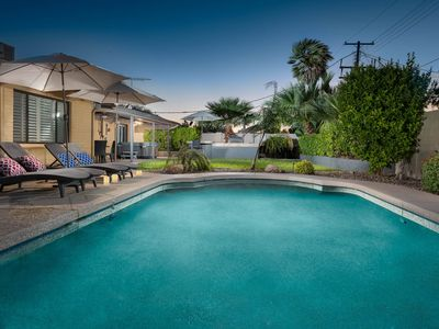 Photo for NEW LISTING! Comfy home w/a private pool, hot tub, outside entertaining space!