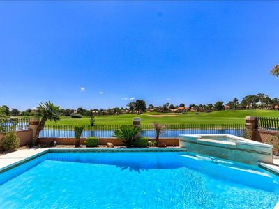 Photo for LUXURY GATED HOME w POOL, PONDS, PALM TREES on GOLF COURSE NEAR STRIP!