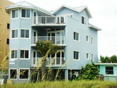 Beach view of Hemmingway House...Unit A is the lower balcony