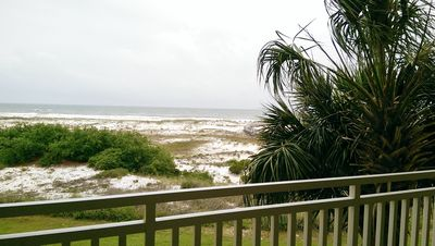 Photo for Beachfront condo w/ pool, tennis and fitness center!