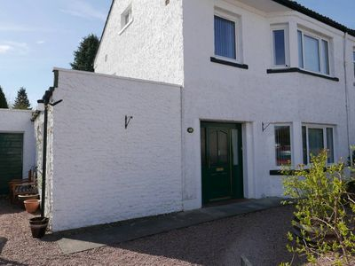 Photo for Large family home with garden patio & play area + free parking central Inverness