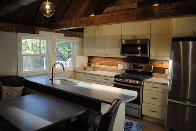 updated & stocked kitchen overlooking the waterfront and deck
