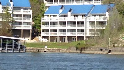 On the water directly! End building- very top floor middle unit - 40 foot deck!