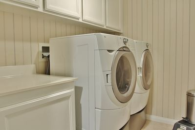 Upstairs laundry room with full size washer/dryer