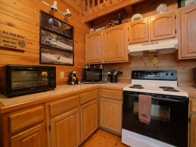 Photo for This classic 2 bedroom + loft cabin features a large vaulted wooden ceiling, wall-to-wall windows, w