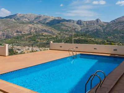 Photo for Apartment with pool in charming village and with beautiful views to the mountain