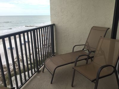 Lounge chairs on the balcony.