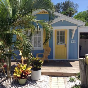 Photo for Beautiful cottage with private decks, grill & free Wifi just steps to the beach