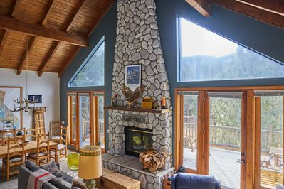 The main room with National Forest views and epic fireplace.