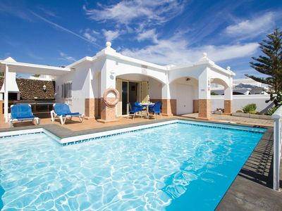 Photo for 4 bedroom Villa, sleeps 8 in Puerto del Carmen with Pool and WiFi