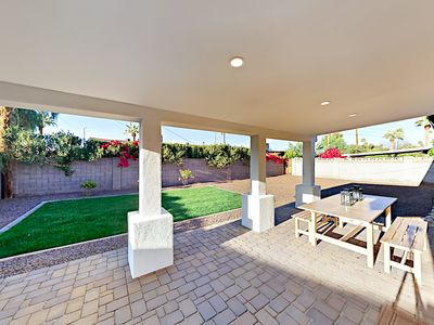 Patio - Entertain in the privacy of your fenced backyard, equipped with a covered patio, grill, and al fresco dining.