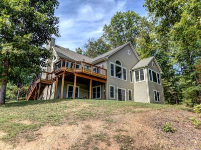 Photo for NEW LISTING! Lakefront home w/swimming area, Ping-Pong, firepit & kitchen