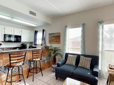 Photo for Sunny home less than a block to the beach - free WiFi & full kitchen!