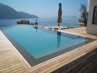 Photo for Villa Doukato- exclusive on Vassiliki bay with private dock, infinity pool.