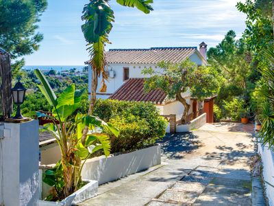 Photo for This 4-bedroom villa for up to 8 guests is located in Nerja and has a private swimming pool, air-con