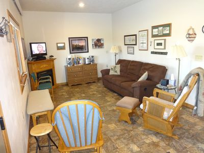 Large living room with plenty of seating. 2 recliners in the couch