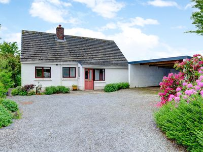 Photo for Sitting in its own large enclosed garden, the 2 bedroomed detached dormer bungalow near Cardigan is