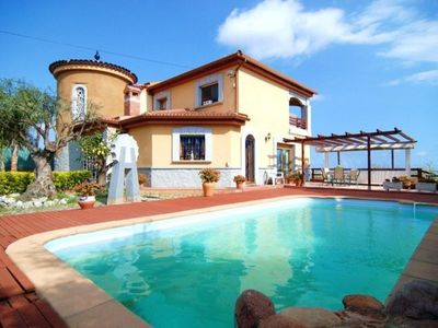 Photo for 5 bedroom Villa, sleeps 12 with Pool, FREE WiFi and Walk to Beach & Shops