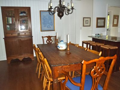 Dining area with kitchen bar in background
