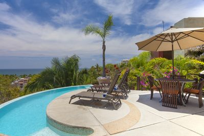 Oceanview pool deck with lots of loungers