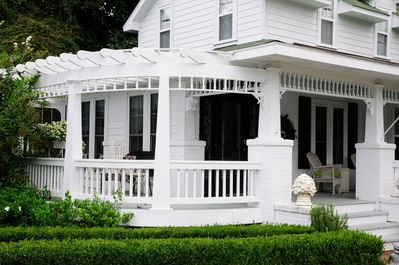 one of 2 covered porches surrounding lovely Magnolia Cottage