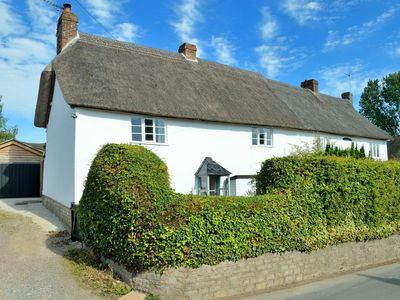 Photo for Pet friendly Grade II listed cottage in village with shops, pubs & great walks