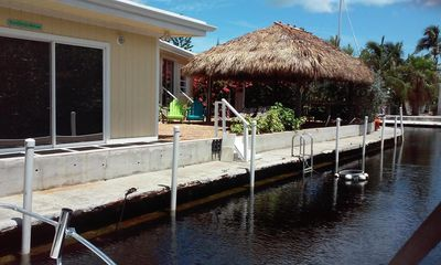 4 bd/2 bath home with Tiki Hut overlooks 2 canals.  Lots of Privacy. Come enjoy!