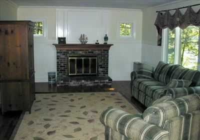Lovely family room with wood fireplace