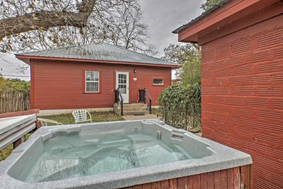 This cozy home offers a private hot tub, where you can take a soak in seclusion.