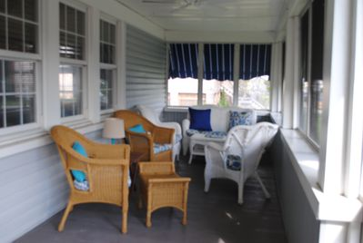 screened front porch with awnings
