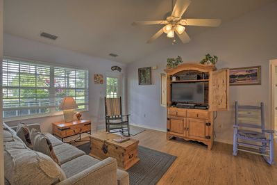 Inside, this charming cottage boasts 3 bedrooms, 2 bathrooms, and sleeps 7!