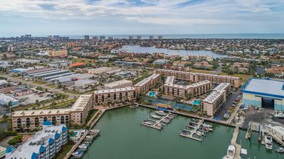 Photo for Updated Tommy Bahama theme unit with Direct Water Views-On-site Tiki Bar and Marina next door!