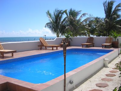 Photo for Caribbean Waterfront Condo Overlooking The Barrier Reef.  Pool, Hot Tub, Wifi