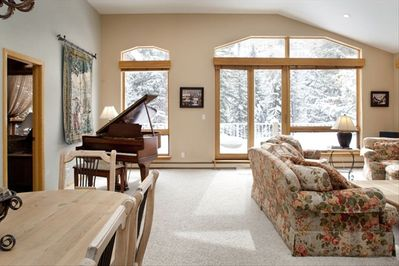 Grand Piano in living area and Dining area