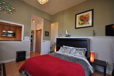 Spacious guest suite with queen-sized bed