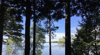 Photo for Authentic lakeside cabin retreat. Crystal clear swimming, sandy bottom, kayak