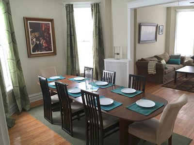 Expandable dining table in formal dining room seats up to 12 comfortably
