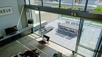 Living area flows to expansive west facing deck