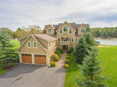 Lakefront home with dock slip, hot tub, and many community amenities!